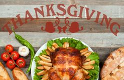 Thanksgiving or Christmas. Homemade roasted whole turkey on wooden table. Thanksgiving Celebration Traditional Dinner Setting. Food Concept royalty free stock images