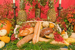 Thanksgiving church altar. A view of a thanksgiving church altar decorated with harvest vegetables and breads Royalty Free Stock Photo