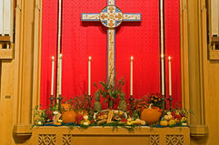 Thanksgiving church altar. A view of a thanksgiving church altar decorated with harvest vegetables and autumn breads Royalty Free Stock Photo