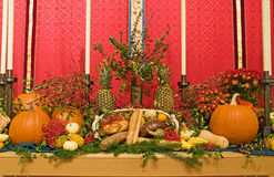 Thanksgiving church altar. A view of a thanksgiving church altar decorated with harvest vegetables and autumn breads Stock Image