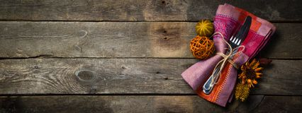 Thanksgiving concept - decorations and silver ware stock photo