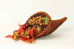 Thanksgiving Cornucopia. This is a Thanksgiving cornucopia, also known as the horn of plenty with fall colored leaves such as yellow, orange and brown. This horn Royalty Free Stock Photo