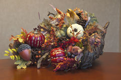 Thanksgiving cornucopia arrangement. Illustrates the fruits of the fall period when Thanksgiving is celebratedrn Stock Photography