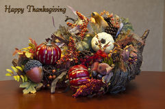 Thanksgiving cornucopia arrangement plus sign. Thanksgiving cornucopia arrangement illustrates the fruits of the fall period when Thanksgiving is celebrated with Royalty Free Stock Images