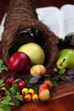 Thanksgiving Cornucopia and the Bible. Thanksgiving arrangement with cornucopia and the Bible in background Royalty Free Stock Photography