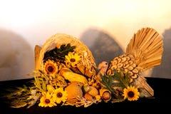 Thanksgiving cornucopia centerpiece with sunflowers and turkey celebrating fall autumn harvest holiday, seasonal symbols of plenty. Thanksgiving cornucopia royalty free stock photography