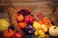 Thanksgiving cornucopia close up against wood royalty free stock photo