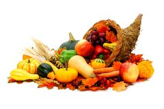 Thanksgiving cornucopia. Filled with fresh harvest vegetables Stock Images