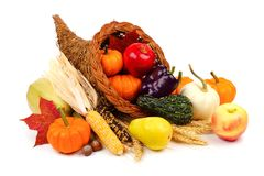 Thanksgiving cornucopia isolated on white. Thanksgiving cornucopia filled with fruit and vegetables isolated on a white background Royalty Free Stock Photos