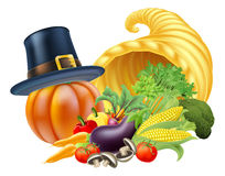 Thanksgiving Cornucopia. Thanksgiving golden horn of plenty cornucopia full of vegetables and fruit produce with a pilgrim or puritan thanksgiving hat Royalty Free Stock Photo