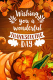 Thanksgiving cornucopia on wood background poster. Thanksgiving Day cornucopia with autumn leaf on wooden background. Fall season harvest horn of plenty full of Royalty Free Stock Image
