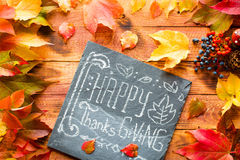Thanksgiving day, autumn leaves background. And text, on different rustic wooden Vector Illustration