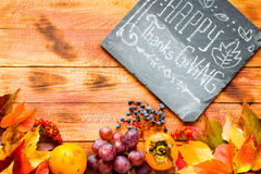 Thanksgiving day, autumn leaves background. And text, on different rustic wooden Stock Illustration