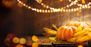 Thanksgiving Day. Autumn Thanksgiving pumpkins. Over wooden background