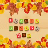 Thanksgiving day background. With leaves and colorful letters. Dry autumn leaves on wooden background. Vector illustration Royalty Free Stock Images