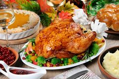 Thanksgiving Day. Baked turkey with vegetables, pumpkin pie, mashed potatoes, garlic buns and Royalty Free Stock Image