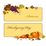 Thanksgiving day banner with grapes, pumpkin and autumn leaves. Stock Photos