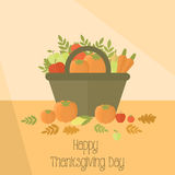 Thanksgiving day basket with pumpkins Stock Photos
