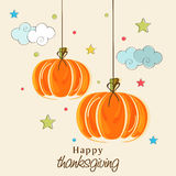 Thanksgiving Day celebration with hanging pumpkin. Stock Photos