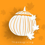 Thanksgiving day celebration with pumpkin and maple leafs. Royalty Free Stock Photos