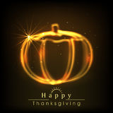 Thanksgiving Day celebration with shiny golden pumpkin. Royalty Free Stock Photos