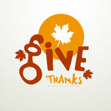 Thanksgiving Day celebration with stylish text. Stylish text of Give Thanks with maple leaf for Thanksgiving Day celebration Stock Photo