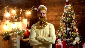 Thanksgiving day and Christmas. Expression and people concept - man with funny face over Christmas background. Christmas. Decorations. Christmas funny Santa stock footage