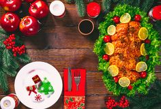 Thanksgiving day. Christmas table dinner time with roasted meats decorated in Christmas style. The concept of a family holiday Stock Photography