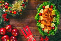 Thanksgiving day. Christmas table dinner time with roasted meats decorated in Christmas style. The concept of a family holiday. Christmas table dinner time with Stock Photo