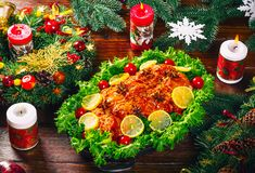 Thanksgiving day. Christmas table dinner time with roasted meats decorated in Christmas style. The concept of a family holiday Royalty Free Stock Photography
