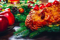 Thanksgiving day. Christmas table dinner time with roasted meats decorated in Christmas style. The concept of a family holiday Stock Photo