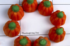 Thanksgiving Day circled with Candied Pumpkins Stock Photography