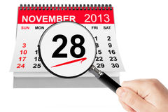 Thanksgiving Day Concept. 28 November 2013 calendar with magnifi. Er on a white background Royalty Free Stock Photo