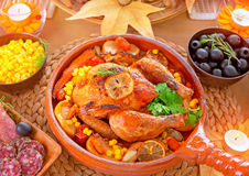 Thanksgiving Day Dinner. Traditional festive food, tasty oven baked turkey with vegetables and lemon, beautiful decorated holiday table Stock Photo