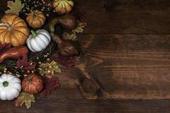 Thanksgiving decor with pumpkins, gourd and squash stock photos