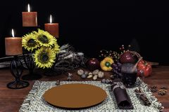 Thanksgiving decor setting for one with candle light stock images