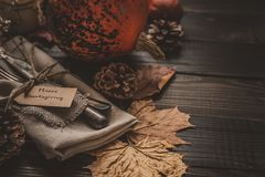 Thanksgiving decoration with cutlery and napkin on the wooden table, close up. Selective focus Stock Image