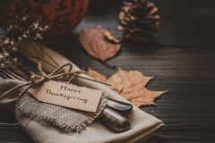 Thanksgiving decoration with cutlery and napkin on the wooden table, close up. Selective focus Royalty Free Stock Photos