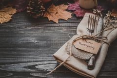Thanksgiving decoration with cutlery and napkin on the wooden table with copy space. Selective focus Royalty Free Stock Images