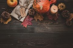Thanksgiving decoration with cutlery and napkin on the wooden table, top view. Copy space.  Royalty Free Stock Images