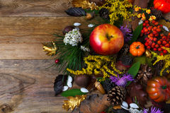 Fall decoration with flowers and apple on wooden table Royalty Free Stock Image