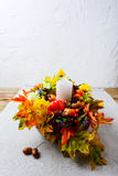 Thanksgiving decoration with silk fall leaves on linen napkin, v Royalty Free Stock Photo