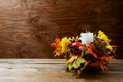 Thanksgiving decoration with silk fall leaves on rustic backgrou Royalty Free Stock Photos