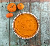 Thanksgiving dessert. Homemade rustic open pumpkin pie with smal Royalty Free Stock Photo