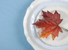Thanksgiving dining table elegant place setting with autumn leaf with copy space. Stock Photos