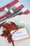 Thanksgiving dining table place setting in modern pale blue, red and white theme - closeup. Stock Photo