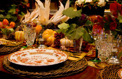Thanksgiving Dinner. A background with a view of the beautiful arrangement of the table for Thanksgiving dinner Royalty Free Stock Image