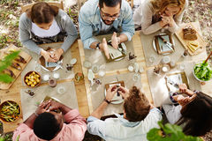 Thanksgiving dinner. Group of young friends gathered at Thanksgiving dinner table stock images