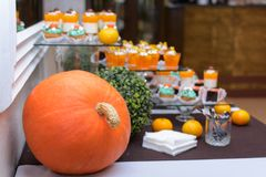 Thanksgiving dinner in a restaurant. Private dining. Horizontal image, indoors, selective focus. A beautiful table setting for Thanksgiving dinner in a royalty free stock photo