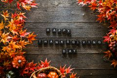 Thanksgiving dinner setting. Autumn leaves on wood royalty free stock photos